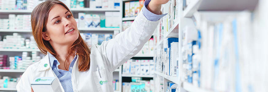 Pharmacist pulling prescription from medication shelf