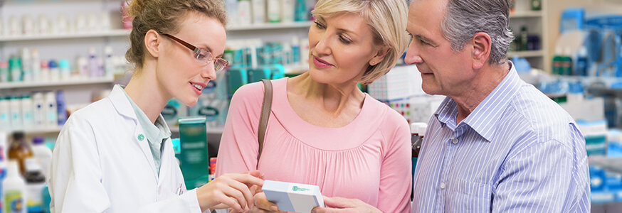 Pharmacist reviewing medication information with customers